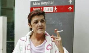 Smoker outside of a hospital. Photo by Olivia Harris via Reuters